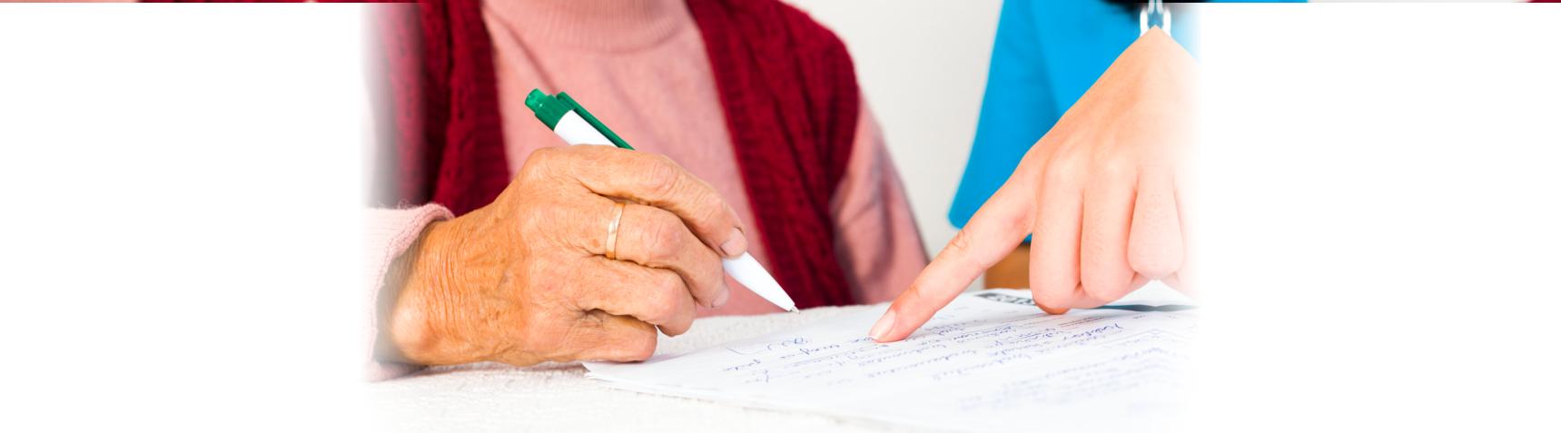 old woman writing something