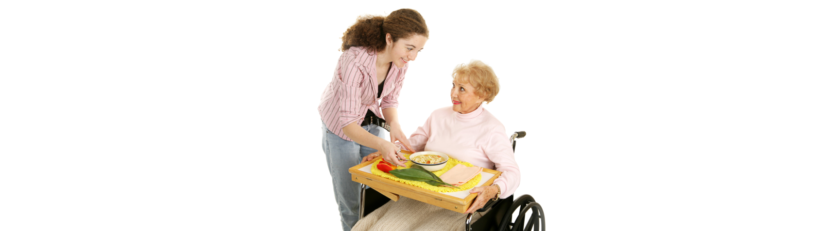 caregiver serving foods to an old woman